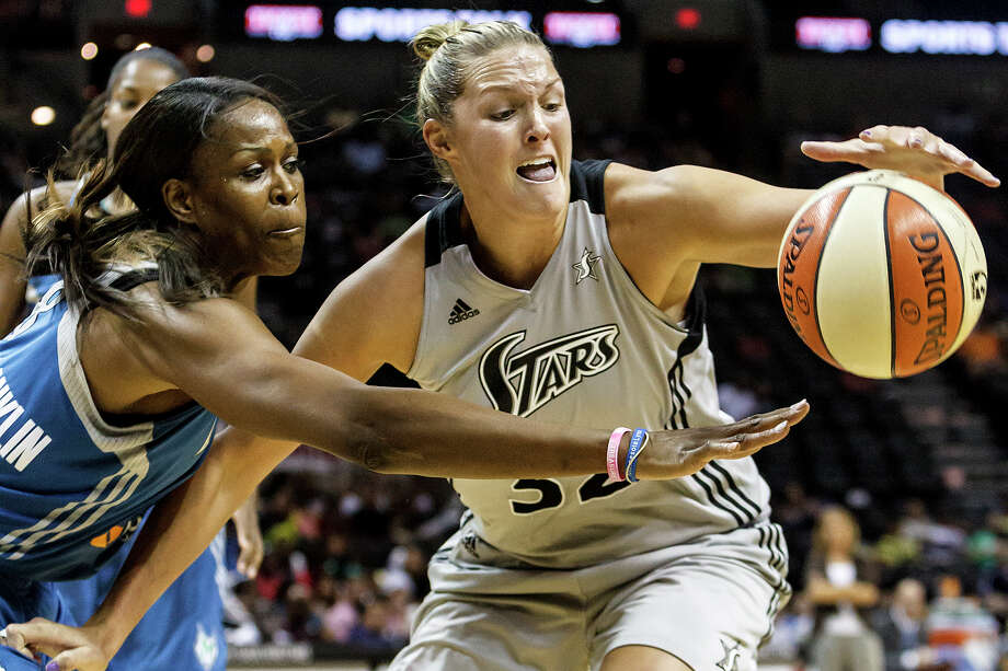 Silver Stars' center Jayne Appel (right) fights for control of the ball with Minnesota's Taj McWilliams-Franklin during the first quarter of their game at the AT&T Center on Sept. 23, 2012.  The Silver Stars came away with a 99-84 victory in the reguar season finale.  MARVIN PFEIFFER/ mpfeiffer@express-news.net Photo: MARVIN PFEIFFER, Express-News / Express-News 2012