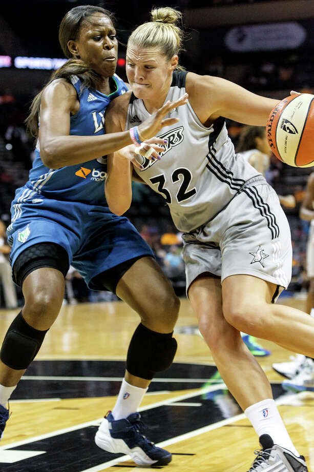 Silver Stars' center Jayne Appel (right) drives to the basket around Minnesota's Taj McWilliams-Franklin during the first quarter of their game at the AT&T Center on Sept. 23, 2012.  The Silver Stars came away with a 99-84 victory in the reguar season finale.  MARVIN PFEIFFER/ mpfeiffer@express-news.net Photo: MARVIN PFEIFFER, Express-News / Express-News 2012