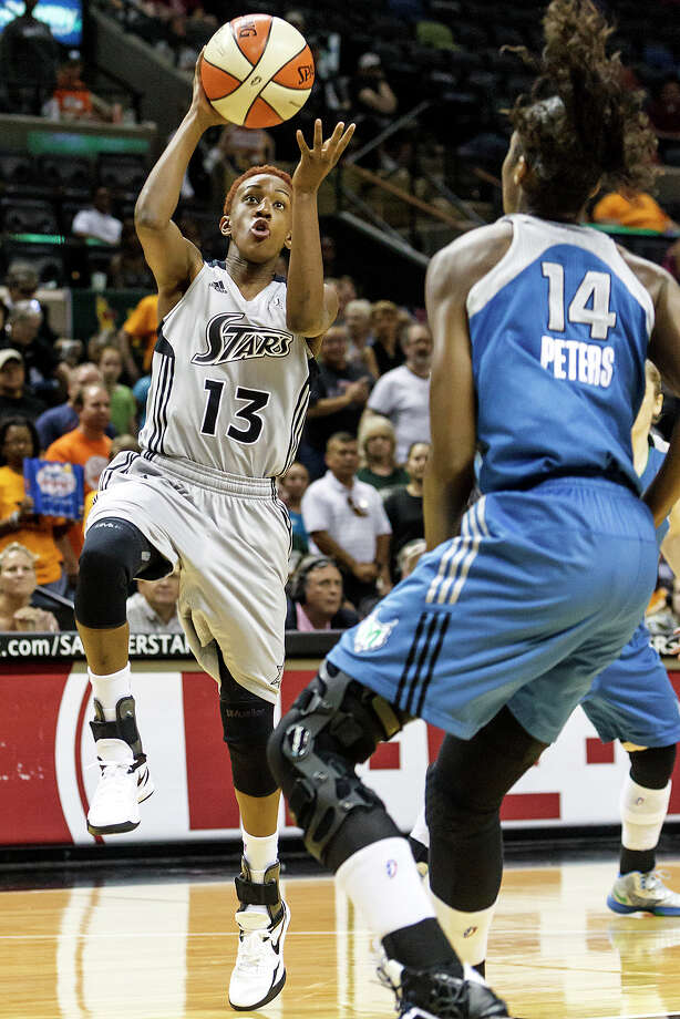 Silver Stars' point guard Danielle Robinson (left) goes up for a shot over Minnesota's Devereaux Peters during the first half of their game at the AT&T Center on Sept. 23, 2012.  The Silver Stars won the game 99-84.  MARVIN PFEIFFER/ mpfeiffer@express-news.net Photo: MARVIN PFEIFFER, Express-News / Express-News 2012