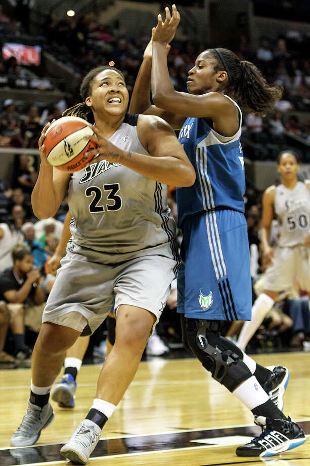 Silver Stars' forward Danielle Adams drives to the basket past Minnesota's Devereaux Peters during the second half of their game at the AT&T Center on Sept. 23, 2012.  Adams led all scorers with 28 points as the Silver Stars came away with a 99-84 victory in the reguar season finale.  MARVIN PFEIFFER/ mpfeiffer@express-news.net Photo: MARVIN PFEIFFER, Express-News / Express-News 2012