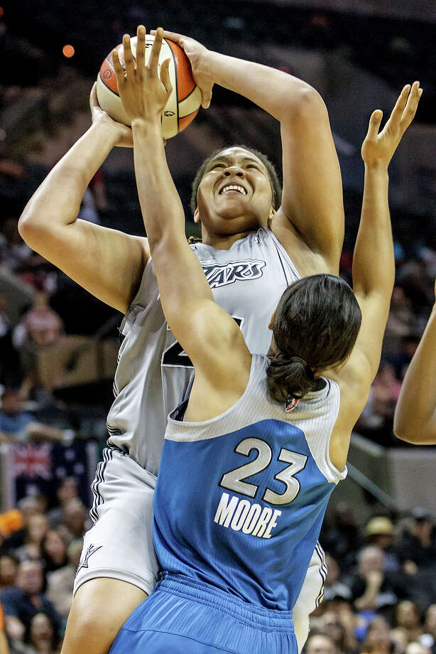 Silver Stars' forward Danielle Adams puts up a shot over Minnesota's Maya Moore during the second quarter of their game at the AT&T Center on Sept. 23, 2012.  Adams led all scorers with 28 points as the Silver Stars came away with a 99-84 victory over the Lynx in the reguar season finale.  MARVIN PFEIFFER/ mpfeiffer@express-news.net Photo: MARVIN PFEIFFER, Express-News / Express-News 2012