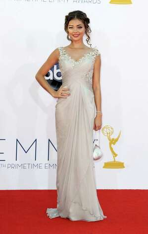 "BEST: Sarah Hyland from ""Modern Family"" simply looks sweet in this gown of uncertain origin, and the 21-year-old actress' hair and minimal accessories are perfect. Photo: MATT SAYLES/INVISION/AP"