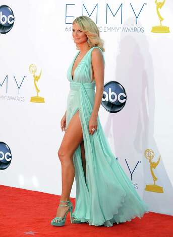 "BEST: Heidi Klum can get away with this extreme version of ""Jolie leg"" in this Alexandre Vauthier couture gown, because as we all know, supermodels are actually aliens who are built differently than the rest of us. Photo: JORDAN STRAUSS/INVISION/AP"