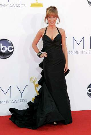 ON THE FENCE: Comedian Kathy Griffin is unexpectedly vivacious in this gown, but the train looks stiff and is reminiscent of a stegosaurus. Photo: MATT SAYLES/INVISION/AP