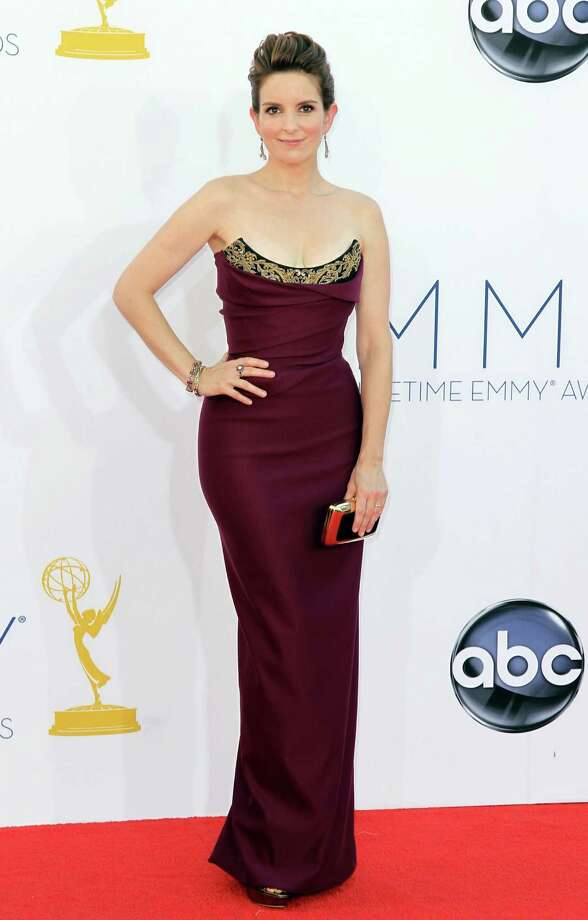 ON THE FENCE: Meanwhile, Tina Fey, who never seems to get it quite right on the red carpet, comes pretty close in a Vivienne Westwood creation that is a great color and beautifully tailored, but marred by a beaded bodice that over-accentuates its odd shape. Photo: MATT SAYLES/INVISION/AP