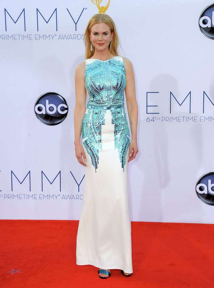 WORST: Actress Nicole Kidman tries on some metallic blue body armor over her white gown. Oh, wait, that's actually part of the Antonio Berardi creation, a long-sleeved version of which was unveiled to the public just six days prior at London Fashion Week. Perhaps a little more time to reflect would have saved her from a rare but serious misstep. Photo: JORDAN STRAUSS/INVISION/AP