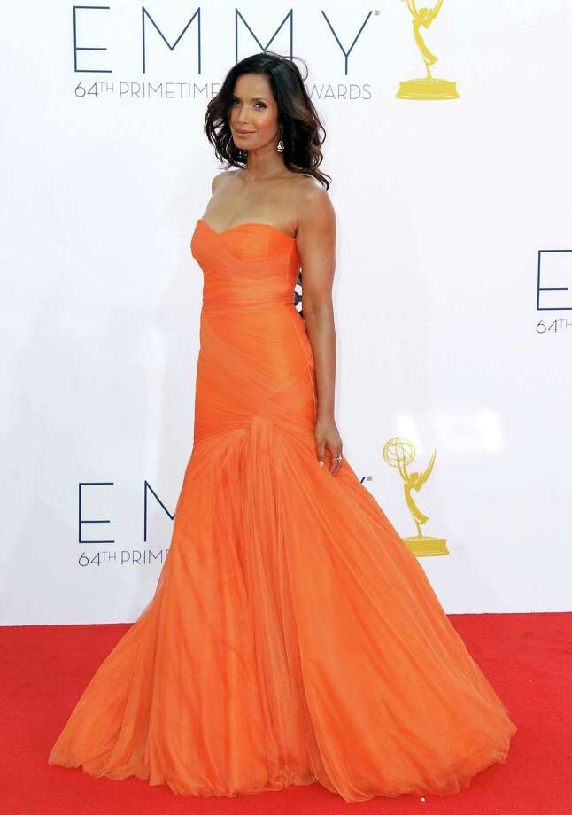 "BEST:Name another celebrity besides ""Top Chef"" host Padma Lakshmi who can wear this color and get away with it. It helps to be a former model with her skin tone and the good sense to stick with a tried-and-true design by Monique Lhuillier. Photo: MATT SAYLES/INVISION/AP"
