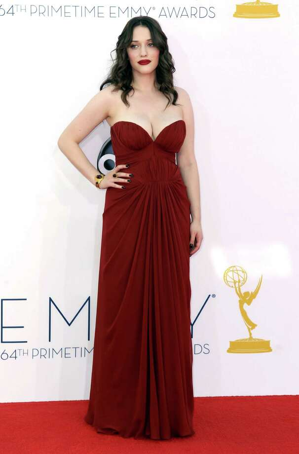 "WORST: By comparison, this is a textbook example of how not to handle voluptuousness. Actress Kat Dennings may be the star of ""2 Broke Girls"" but here she looks like ""1 Clueless Girl"" in a J.Mendel gown that tells too much of a story and is topped off by lipstick that's too intense and just-woke-up hair. Photo: MATT SAYLES/INVISION/AP"