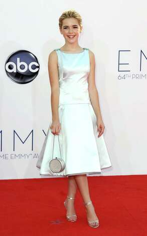 "BEST: Designer Zac Posen custom-made this dress for Kiernan Shipka, who at 12 has been growing up before our eyes on ""Mad Men."" It's got clean lines, is shiny and beautiful and it's age-appropriate. Photo: MATT SAYLES/INVISION/AP"