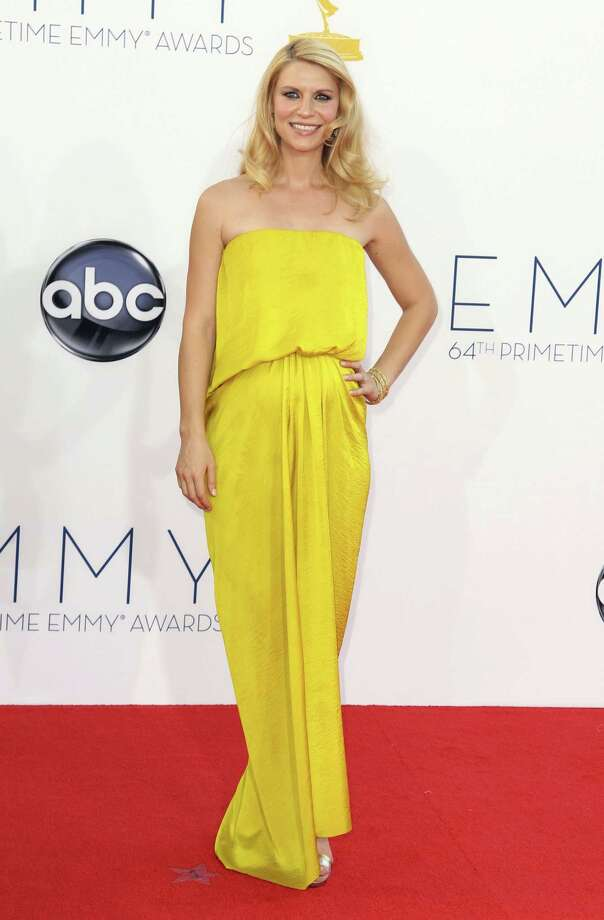 "ON THE FENCE:What's with all the yellow? Claire Danes from ""Homeland"" may be wearing a not-so-great color by Lanvin, but this is an interesting and chic take on a maternity dress and she looks beautiful. Photo: MATT SAYLES/INVISION/AP"