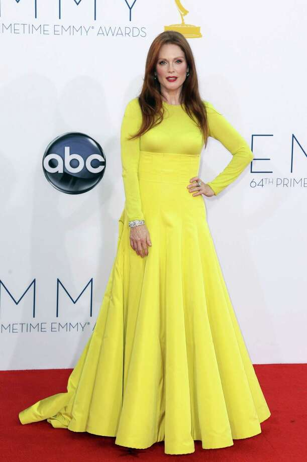 "WORST: Julianne Moore, nominated for best actress in a miniseries or movie for her role as Sarah Palin in ""Game Change,"" takes the bottom rung here in a Christian Dior couture gown in a color usually reserved by Nike for runners' gear in Spandex and college football uniforms. It hurts the eyes just to look at this. Photo: MATT SAYLES/INVISION/AP"