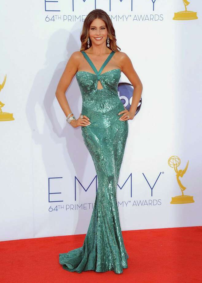 """BEST:If you look up """"voluptuous"""" in the dictionary, you'll see a picture of """"Modern Family"""" actress Sofia Vergara. The wrong gown on a body like this would look campy at best, vulgar at worst. Photo: JORDAN STRAUSS/INVISION/AP"""