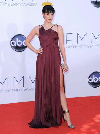 BEST: Actress Jena Malone shows us how asymmetry and the trend du jour, a peek-a-boo leg popularized by Angelina Jolie from last winter's Oscars, can work in perfect harmony. Photo: JORDAN STRAUSS/INVISION/AP