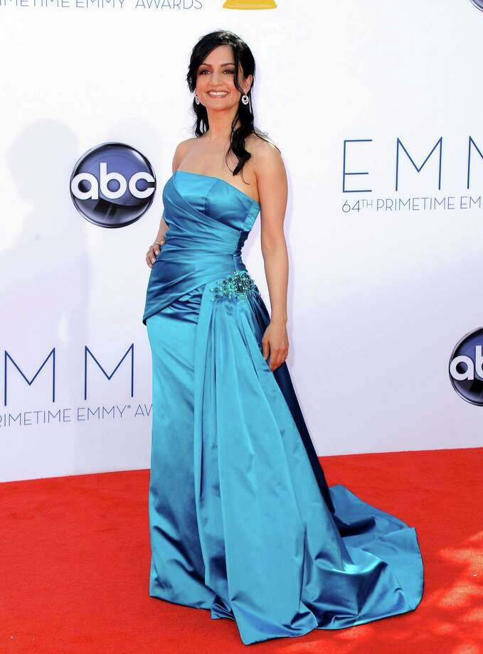 Archie Panjabi  The color is lovely. The peacock tail is ridiculous. Photo: JORDAN STRAUSS/INVISION/AP