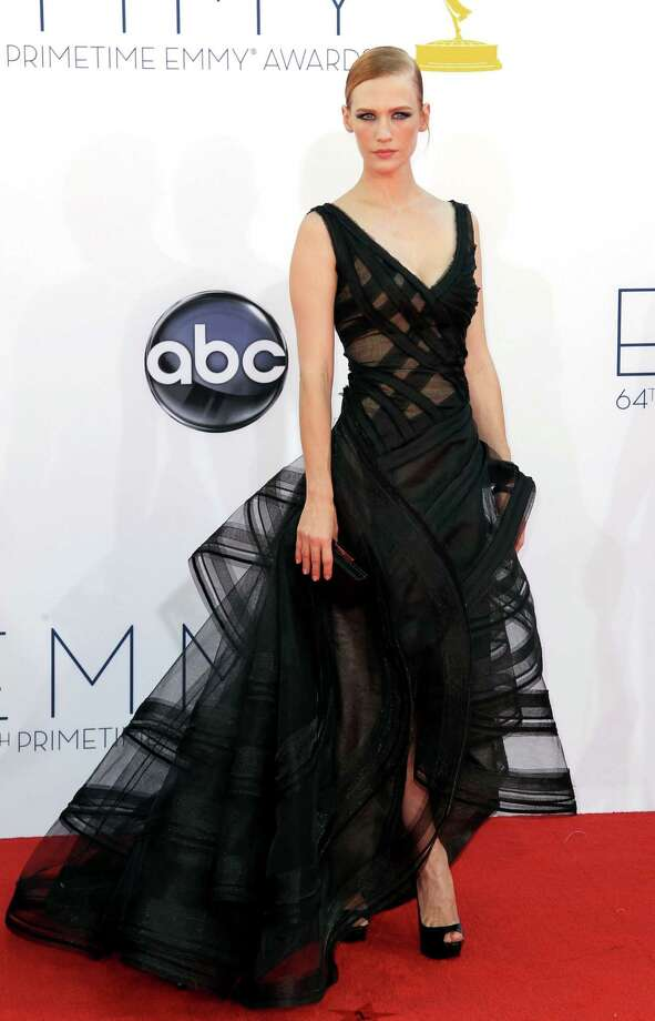"BEST:""Mad Men"" actress January Jones has been the victim of a few missteps on the red carpet in the past, but this Zac Posen design incorporates both sharp angles and big, round curves, and looks light as a feather.  Photo: MATT SAYLES/INVISION/AP"