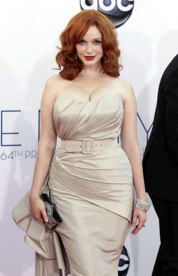 "ON THE FENCE:The fit and the color are perfect for ""Mad Men"" star Christina Hendricks' dramatic natural coloring, but the belt looks like it was pulled off the rack at Target and cheapens the overall effect. Photo: MATT SAYLES/INVISION/AP"