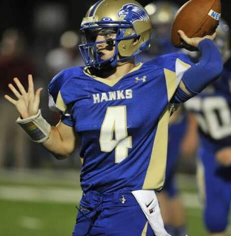 Newtown quarterback Andrew Tarantino throws the ball during their game against Pomperaug at Newtown High School on Friday, Sept. 21, 2012. Newtown won, 42-7. (Jason Rearick / Jason Rearick)