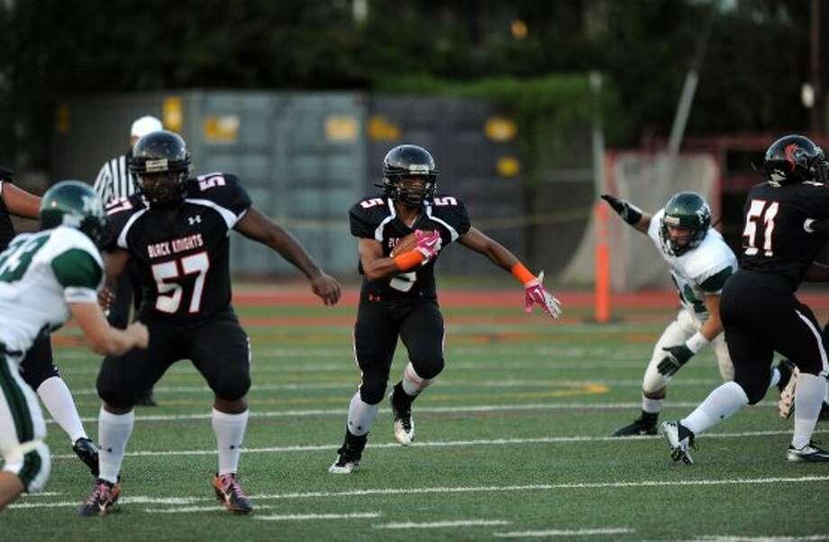 Stamford's Cameron Webb carries the ball during Friday's game against Norwalk High School at Stamford High School on September 21, 2012. (Lindsay Niegelberg / Lindsay Niegelberg)