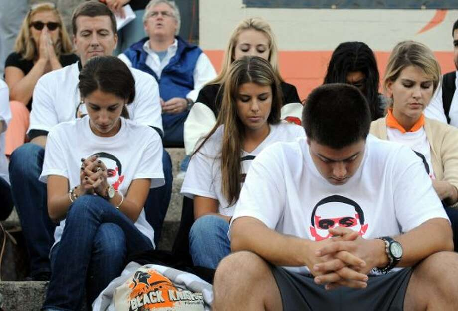 Spectators at Friday's football game at Stamford High School on September 21, 2012, wore t-shirts with an image of Marcus Dixon and bowed their heads for a moment of silence to remember the former running back who died in an accidental shooting September 13, 2012. (Lindsay Niegelberg / Lindsay Niegelberg)