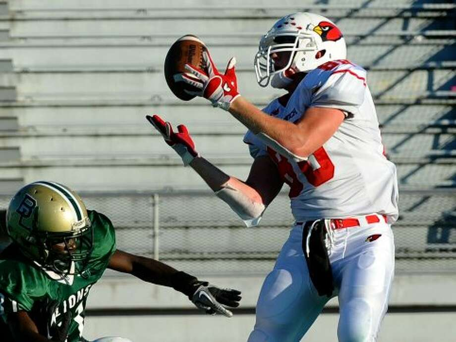 Greenwich's #80 Joe Kelly catches the ball in the endzone for a touchdown, during football action against Bassick in Bridgeport, Conn. on Friday September 21, 2012. (Christian Abraham / Christian Abraham)