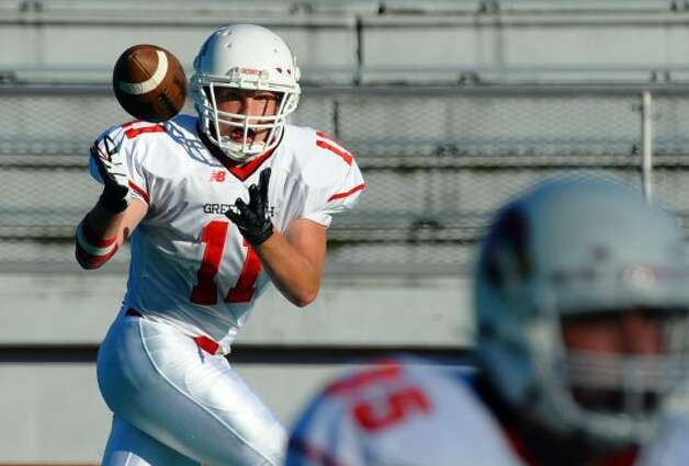 Greenwich's #11 Alex McMurray during football action against Bassick in Bridgeport, Conn. on Friday September 21, 2012. (Christian Abraham / Christian Abraham)