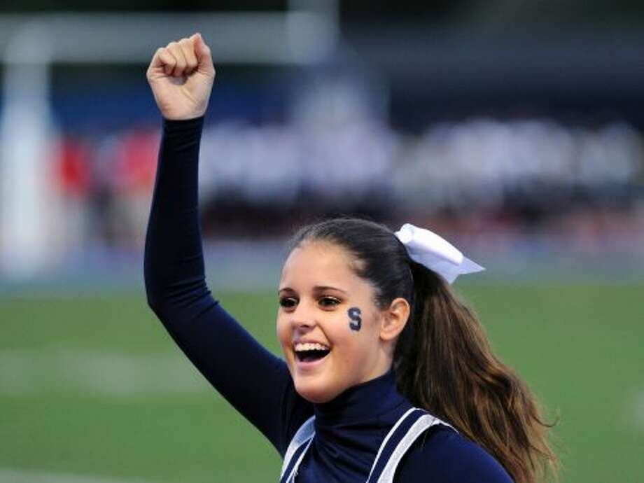 Staples cheerleader Lindsey Gianitti, a sophomore, cheers during the high school football game between Staples High School and Bridgeport Central High School at Staples in Westport, Friday night, Sept. 21, 2012. (Bob Luckey)