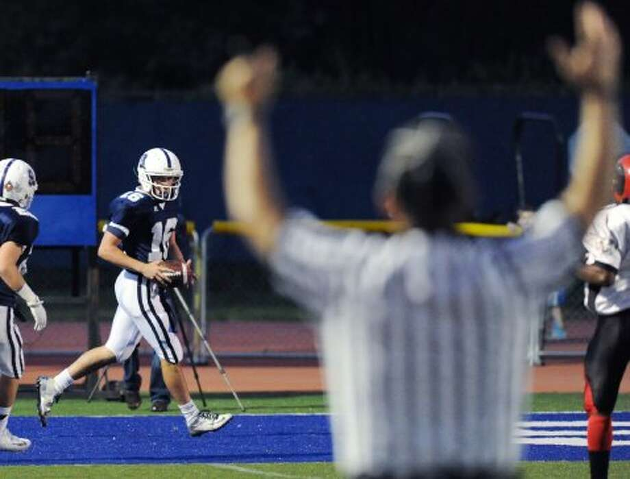 Staples quarterback Jack Massie # 16 after scoring a touchdown on a first quarter run during the high school football game between Staples High School and Bridgeport Central High School at Staples in Westport, Friday night, Sept. 21, 2012. (Bob Luckey)
