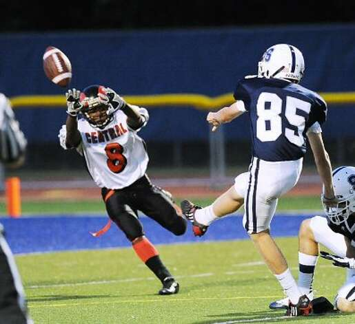 Liam Gilmore # 85 of Staples hits on an extra point during the first quarter in the Hhgh school football game between Staples High School and Bridgeport Central High School at Staples in Westport, Friday night, Sept. 21, 2012. (Bob Luckey)