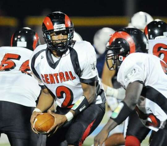 Xavier Hardison, # 2, the Bridgeport Central quarterback, hands off to teammate Andrew Louis # 23 during the high school football game between Staples High School and Bridgeport Central High School at Staples in Westport, Friday night, Sept. 21, 2012. (Bob Luckey)
