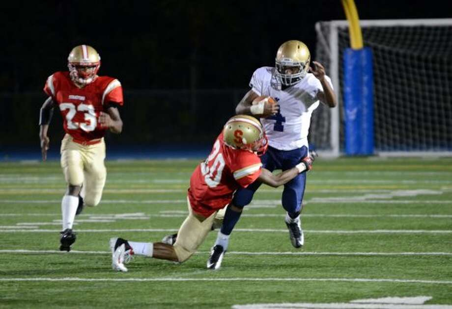 Stratford's Dana Smith (20) takes down Notre Dame Fairfield's Tajik Bagley (4) during the football game at Bunnell High School in Stratford on Friday, Sept. 21, 2012. (Amy Mortensen)