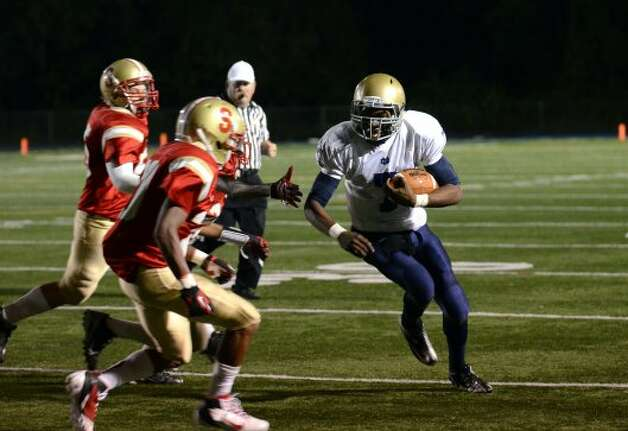 Notre Dame Fairfield's Glody Tumba (7) carries the ball during the football game against Stratford at Bunnell High School in Stratford on Friday, Sept. 21, 2012. (Amy Mortensen)