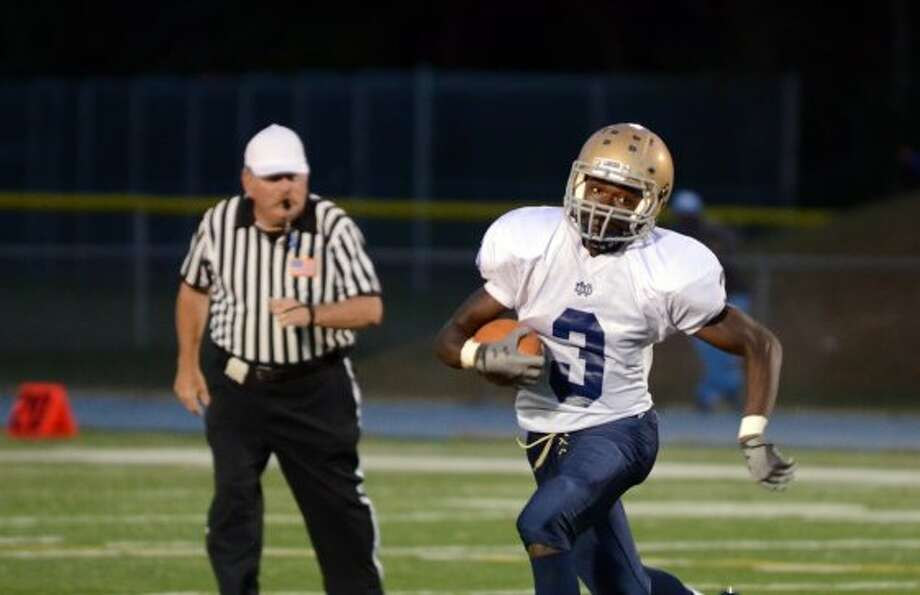 Notre Dame Fairfield's Marcus Fulton (3) carries the ball during the football game against Stratford at Bunnell High School in Stratford on Friday, Sept. 21, 2012. (Amy Mortensen)