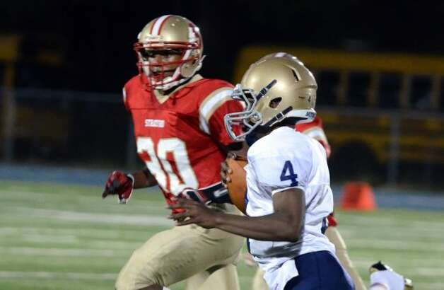 Notre Dame Fairfield's Tajik Bagley (4) carries the ball during the football game against Stratford at Bunnell High School in Stratford on Friday, Sept. 21, 2012. (Amy Mortensen)