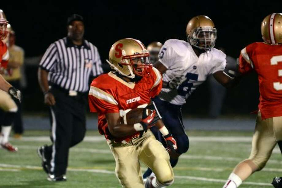 Stratford's Dana Smith (20) carries the ball during the football game against Notre Dame Fairfield at Bunnell High School in Stratford on Friday, Sept. 21, 2012. (Amy Mortensen)