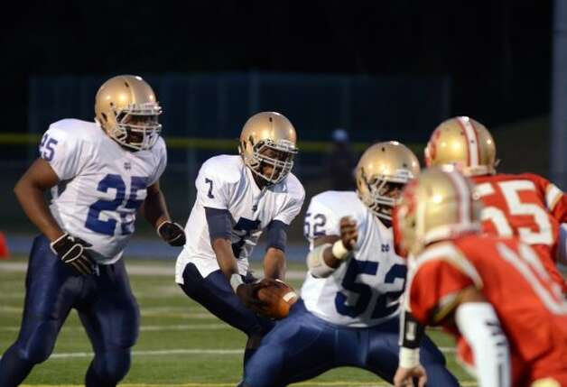Notre Dame Fairfield's Glody Tumba (7) grabs the ball during the football game against Stratford at Bunnell High School in Stratford on Friday, Sept. 21, 2012. (Amy Mortensen)