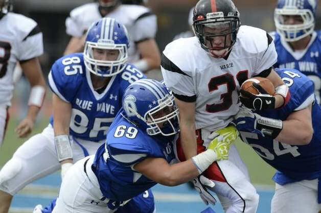 Warde's #31 T.J. Gallagher gains some yardage as Darien High School hosts Fairfield Warde High School in varsity football in Darien, CT on Sept. 22, 2012. (Shelley Cryan)