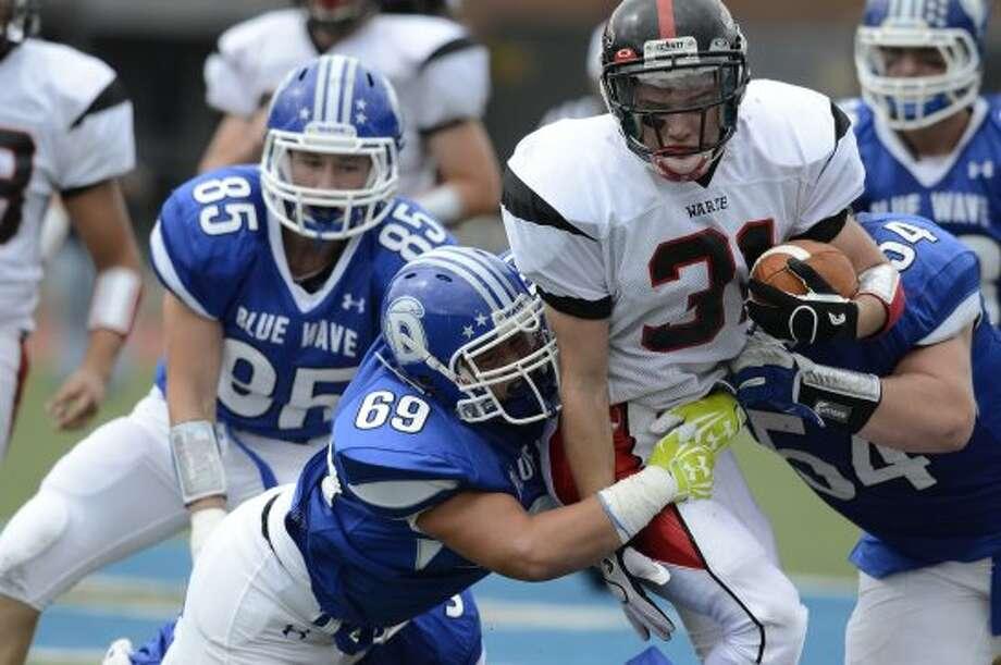Warde's #31 T.J. Gallagher gains some yardage as Darien High School hosts Fairfield Warde High School in varsity football in Darien, CT on Sept. 22, 2012. (Shelley Cryan)