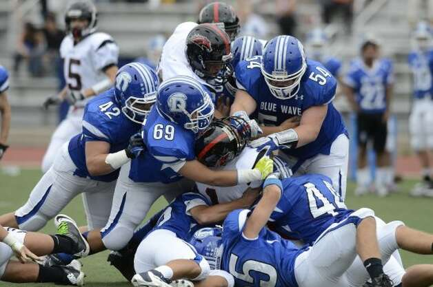 Warde's #1 Colin Ventura is surrounded as Darien High School hosts Fairfield Warde High School in varsity football in Darien, CT on Sept. 22, 2012. (Shelley Cryan)