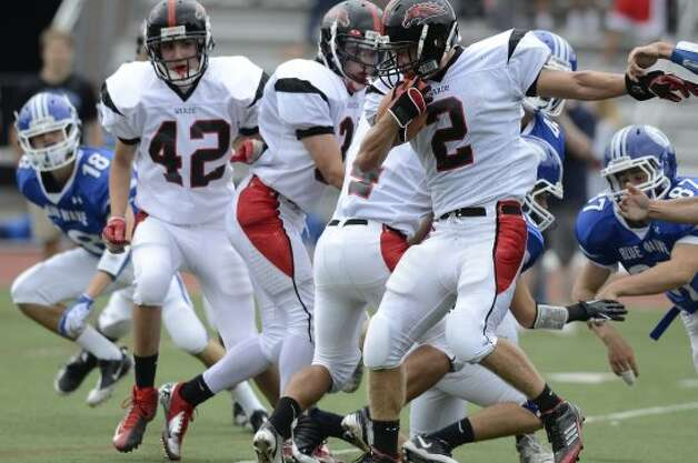 Warde's #2 Ryan Jacob looks to gain some yardage as Darien High School hosts Fairfield Warde High School in varsity football in Darien, CT on Sept. 22, 2012. (Shelley Cryan)
