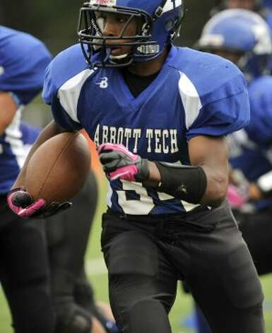 Abbott Tech's Dominique Rogers runs with the ball during their game against Cheney Tech at Perry Memorial Field in Rogers Park in Danbury on Saturday, Sept. 22, 2012. Cheney Tech won, 28-26 in overtime. (Jason Rearick)