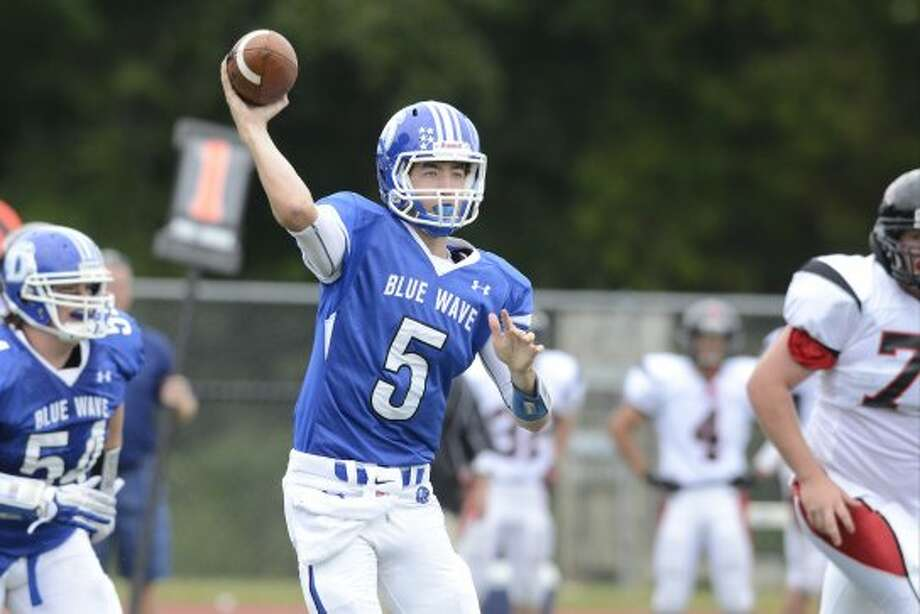 Darien's $5 Henry Baldwin throws a pass as Darien High School hosts Fairfield Warde High School in varsity football in Darien, CT on Sept. 22, 2012. (Shelley Cryan)