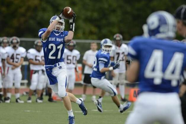 Darien's #21 Nicholas Lombardo pulls down a pass as Darien High School hosts Fairfield Warde High School in varsity football in Darien, CT on Sept. 22, 2012. (Shelley Cryan)