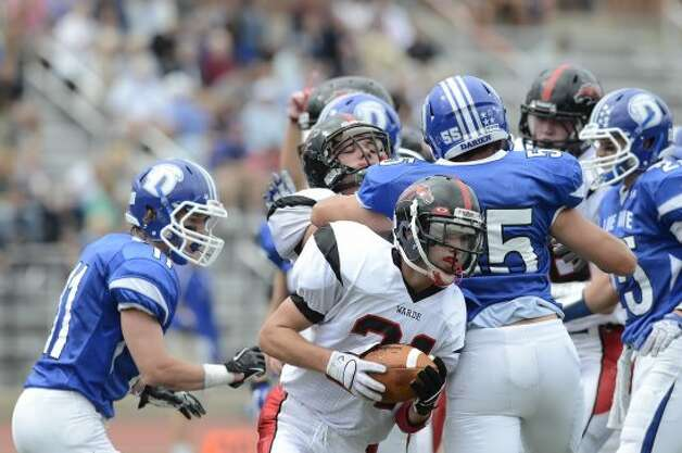 Warde's #31 T.J. Gallagher puts his team on the board as Darien High School hosts Fairfield Warde High School in varsity football in Darien, CT on Sept. 22, 2012. (Shelley Cryan)