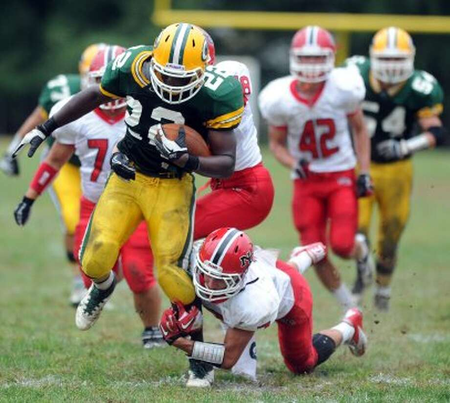 Trinity Catholic's Shaquan Howsie carries the ball during Saturday's game against New Canaan at Trinity Catholic High School on September 22, 2012. (Lindsay Niegelberg)