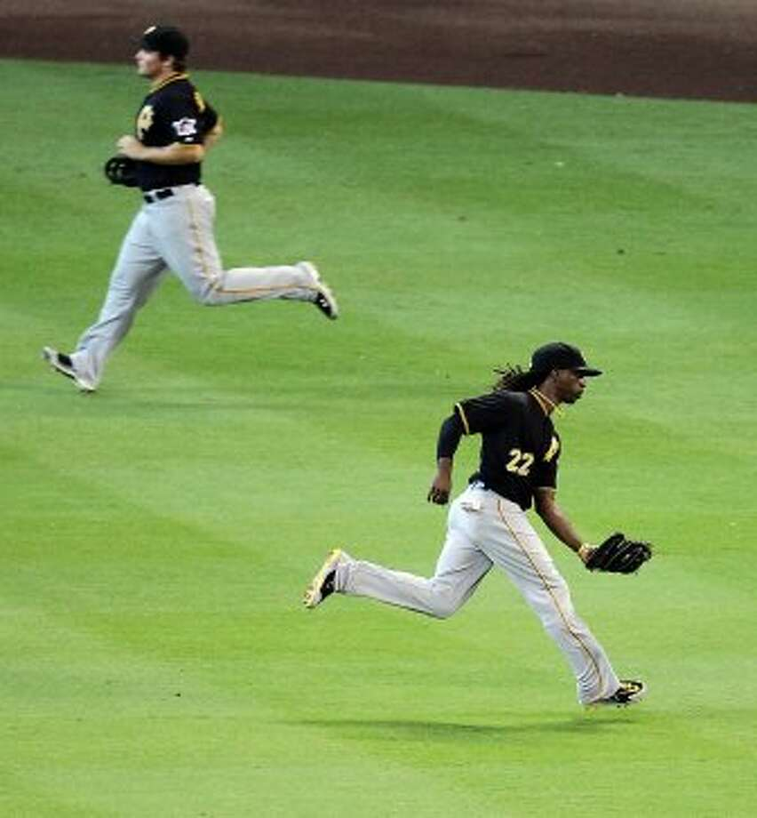 Pirates center fielder Andrew McCutchen runs down a shallow hit for an out. (Nick de la Torre / © 2012 Houston Chronicle)