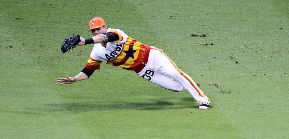 Astros center fielder Brandon Barnes a diving catch to end the first inning. (Nick de la Torre / © 2012 Houston Chronicle)
