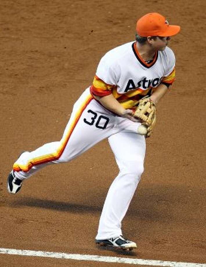 Astros third baseman Matt Dominguez commits an error during the top of the third inning.  (Nick de la Torre / © 2012 Houston Chronicle)