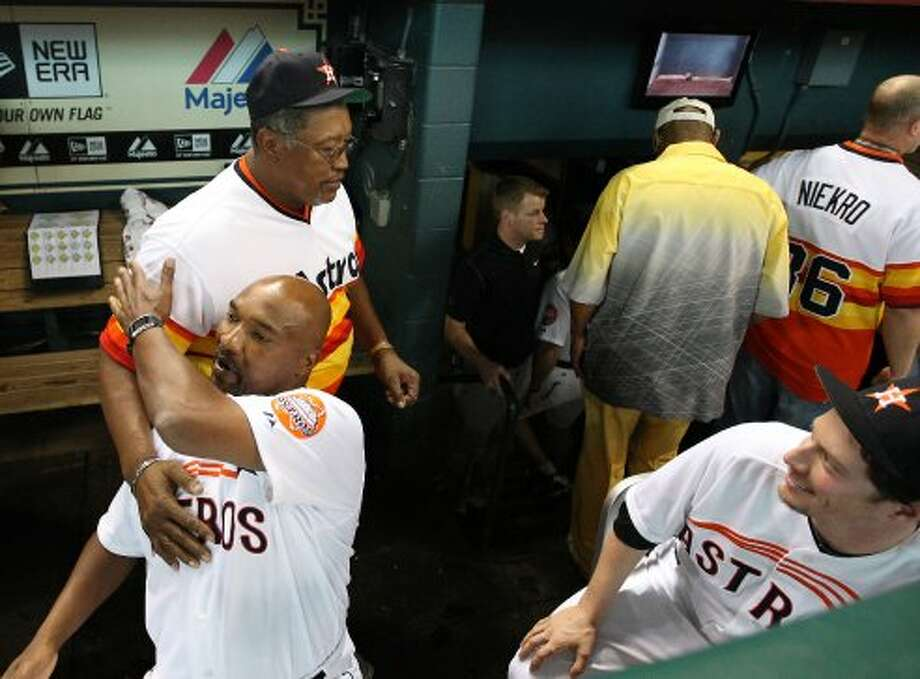 Houston Astros third base coach Dave Clark (35) gets a hug from J.R. Richard in the dugout after the Astros 50th Anniversary ceremony before the start of an MLB baseball game at Minute Maid Park on Saturday, Sept. 22, 2012, in Houston.  ( Karen Warren / Houston Chronicle ) (Houston Chronicle)