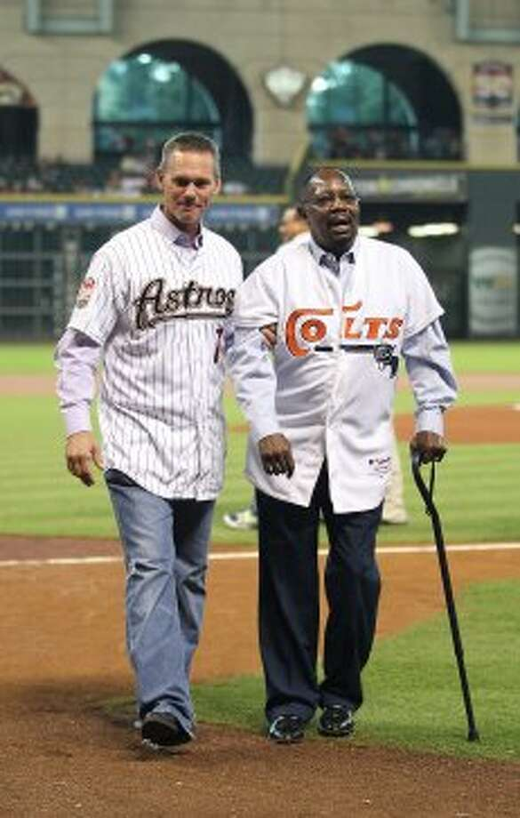 Craig Biggio helps Jimmy Wynn off the field after the Astros 50th Anniversary ceremony before the start of an MLB baseball game at Minute Maid Park on Saturday, Sept. 22, 2012, in Houston.  ( Karen Warren / Houston Chronicle ) (Houston Chronicle)