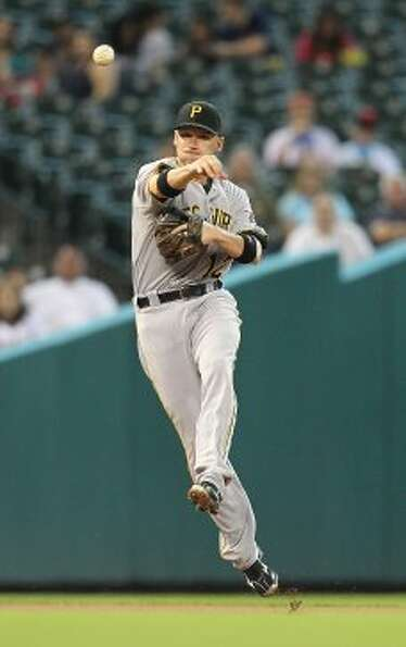 Pittsburgh Pirates shortstop Clint Barmes (12) tries to throw the single by Houston Astros second ba